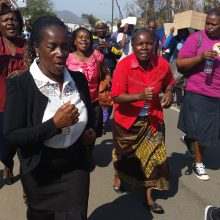 Rita in black and white clothes and behind her on the left side Teresa at a march during SADC People's Summit in Swaziland August 2016.
